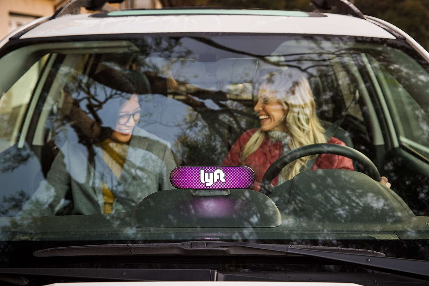 Lyft carpool vehicle with two women