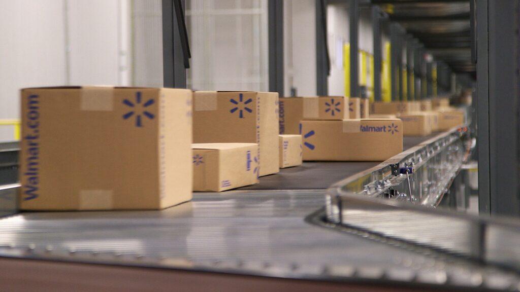 Walmart boxes on conveyor belt